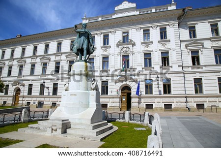 Statue of Lajos Kossuth and governmental building in Pecs, Hungary. - stock photo