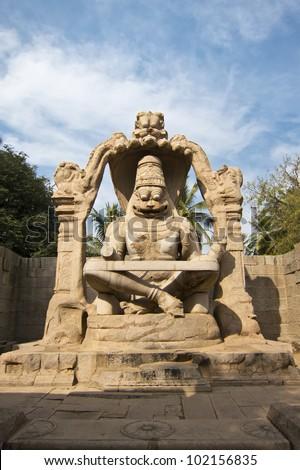 Statue of Lakshmi Narasimha, the fourth incarnation of Lord Vishnu, Hampi, Karnataka state, India - stock photo
