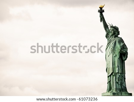 Statue of Liberty against dramatic clouds