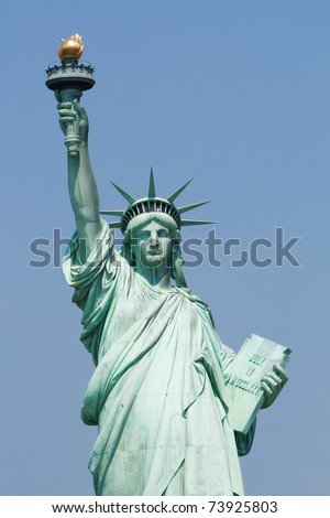 Statue of Liberty against the blue sky - stock photo