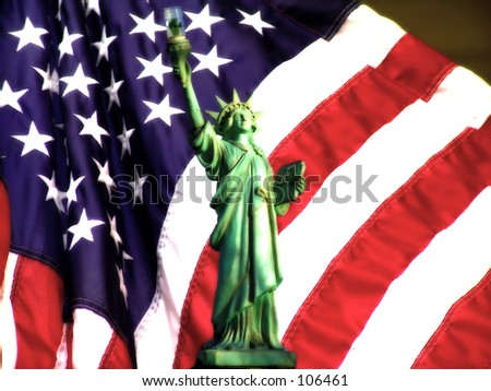 Statue of Liberty and American Flag With Blur Effect - stock photo