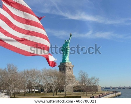 Statue of Liberty and flag - stock photo
