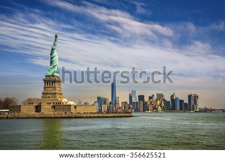 Statue of Liberty and Manhattan, New York - stock photo
