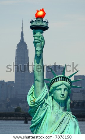 Statue of Liberty and New York City skyline at dark