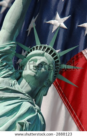 Statue of Liberty and US Flag - stock photo