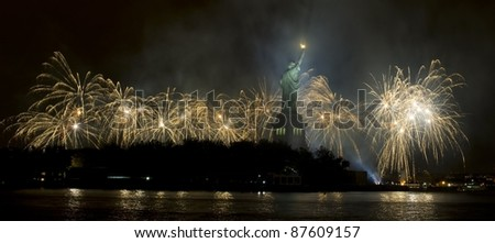 Statue of Liberty at night with fireworks in the background