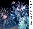 Statue of Liberty at night with fireworks, New York, USA - stock photo