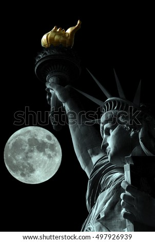 Statue of Liberty at night with the moon in the background
