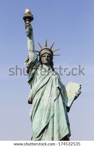 Statue of liberty at Odaiba, Tokyo, Japan at rainbow bridge across Tokyo bay. Blue sky and little cloud.  - stock photo