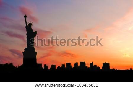 Statue of liberty at sunset - stock photo