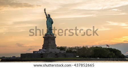 Statue of Liberty at sunset - stock photo