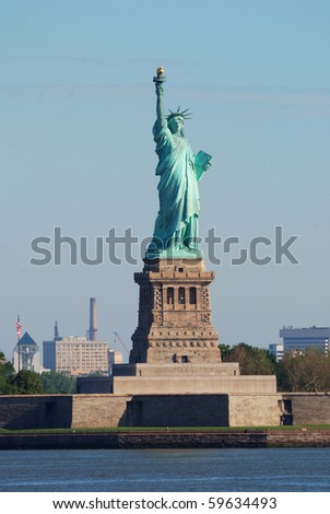 Statue of Liberty closeup in New York City Manhattan Hudson River - stock photo