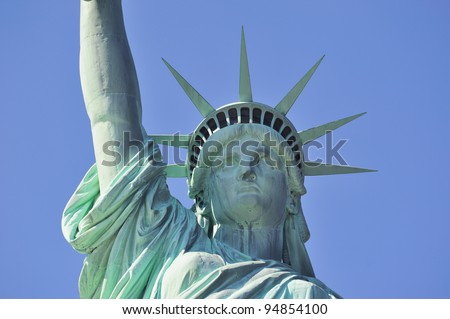 Statue of Liberty closeup with blue sky in New York City Manhattan