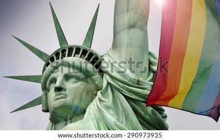 Statue of liberty in New York and rainbow flag  - stock photo