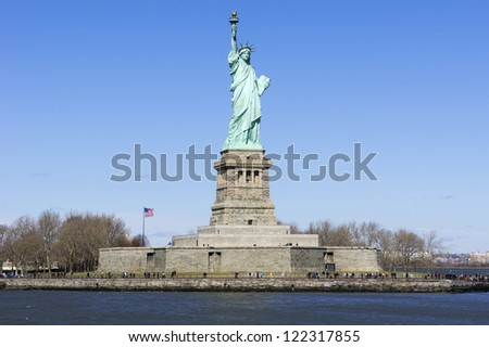 Statue of Liberty in New York set against a clear blue sky - stock photo