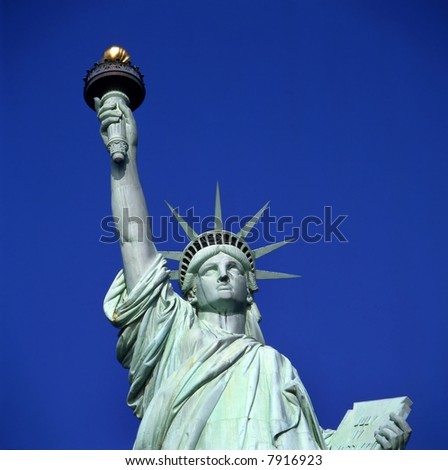 Statue of Liberty in New York USA against clear blue sky - stock photo