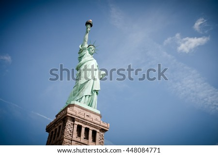 Statue of Liberty in Sunshine and Blue Sky New York City - stock photo