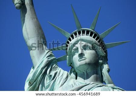 Statue of Liberty (Liberty Enlightening the World) on Liberty Island in New York Harbor - stock photo