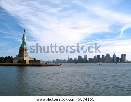 Statue of Liberty, New York Harbor, and Lower Manhattan skyline (New York City). - stock photo