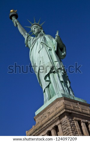 Statue of Liberty on a Blue sky - stock photo