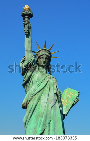Statue of Liberty on blue clear sky - stock photo