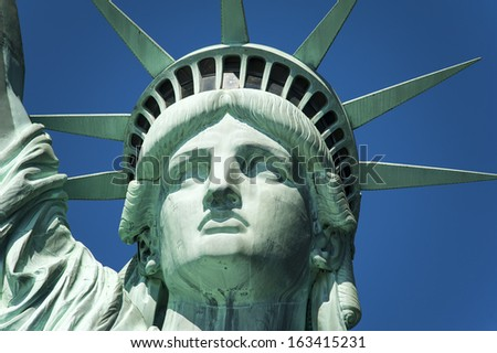 Statue of Liberty on Hudson River in NYC - stock photo
