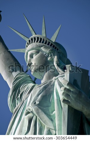 Statue of Liberty on Hudson River in NYC. - stock photo