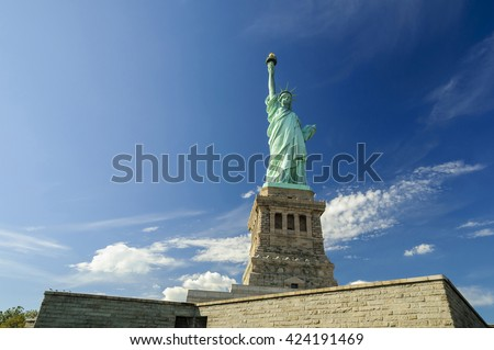 Statue of Liberty on Liberty Island against blue sky, New York City, USA