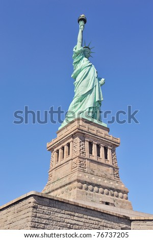 Statue of Liberty on Liberty Island closeup with blue sky in New York City Manhattan - stock photo