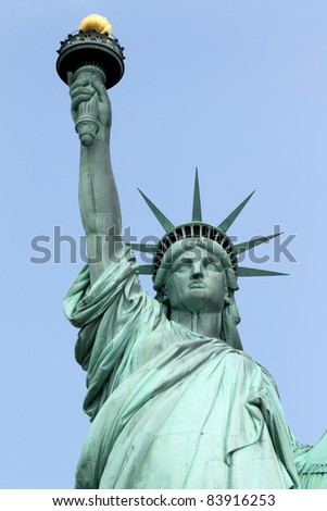 Statue of Liberty on Liberty Island in New York City. - isolated on blue background - stock photo