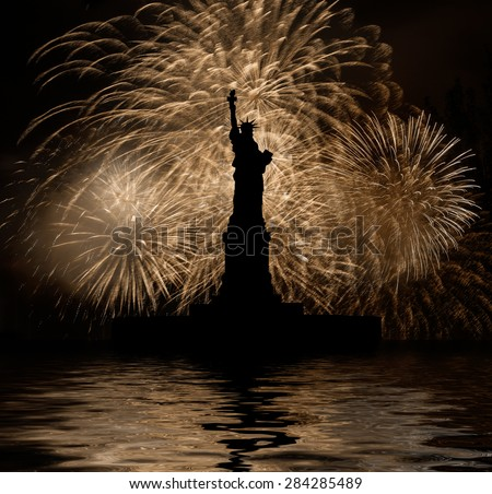 Statue of Liberty on the background of golden fireworks, independence day - stock photo