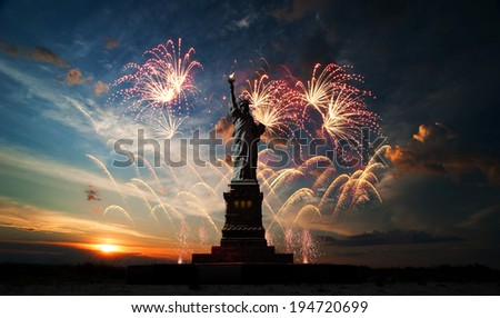 Statue of Liberty on the background of sunrise and fireworks - stock photo