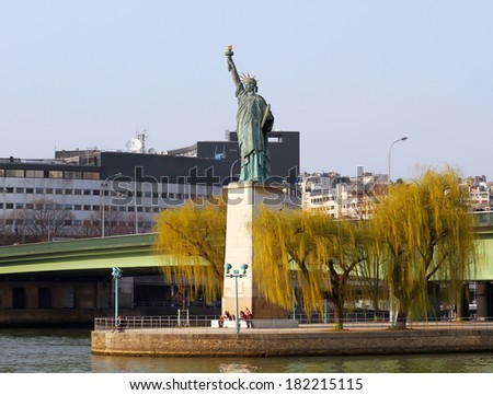 Statue of Liberty on the swan island in Paris, France - stock photo