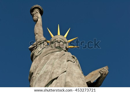 Statue of Liberty on the swan island in Paris, France