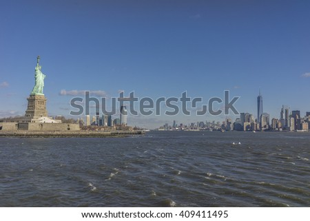 Statue of Liberty sculpture on Liberty Island in New York Harbor in New York City - stock photo
