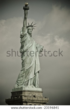 Statue of Liberty side view with clouds on background - stock photo