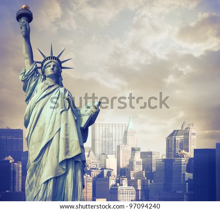 Statue of Liberty with cityscape in the background - stock photo