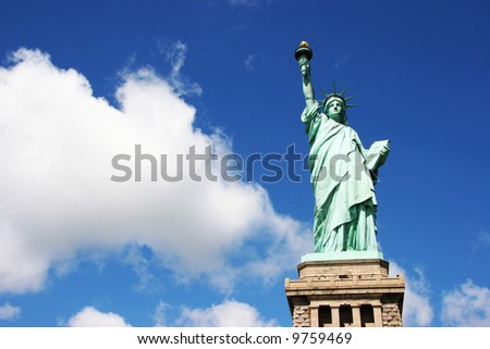 Statue of Liberty with deep blue skys and clouds - stock photo