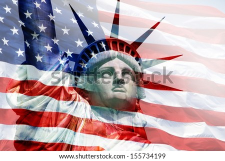 Statue of Liberty with flag of the United States of America  - stock photo