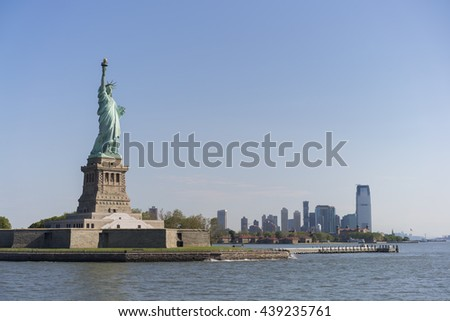 Statue of Liberty with New Jersey in background - stock photo