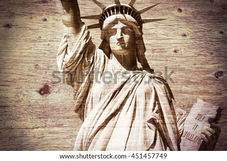 Statue of Liberty, wooden textured background - stock photo
