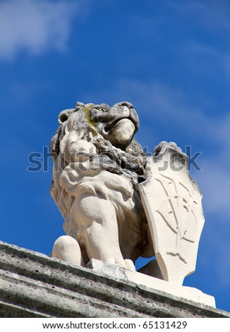statue of lion holding shield in town of perast in the balkan country of montenegro - stock photo