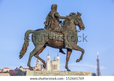 Statue of Louis XIV and Fourviere basilica on a background - stock photo
