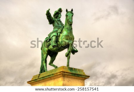 Statue of Louis XIV in front of the Palace of Versailles near Pairs - stock photo