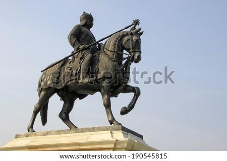 Statue of Maharana Pratap with sword riding on his horse Chetak at Pratap Smarak on Moti Magri Hill in Udaipur, Gujarat, India, Asia - stock photo
