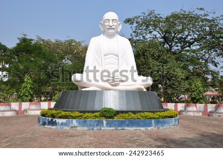 Statue of Mahatma Gandhi in a public park. - stock photo