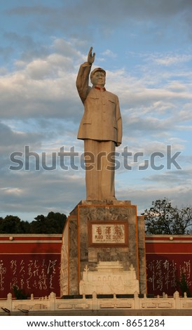 Statue of Mao Tse Tung, Lijiang, Yunnan, China.  During the 60s-80s Mao statues were everywhere in China and became a symbol of the Cultural Revolution.  No property release is required. - stock photo
