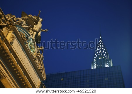 Statue of Mercury at Grand Central Terminal in New York City, with the Chrysler Building inthe background - stock photo