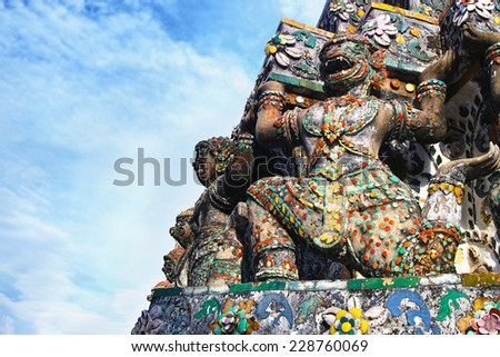 Statue of Monkey Deva at Wat Arun. Wat Arun or Temple of the Dawn is one of a famous Buddhist temple in Bangkok, Thailand.  - stock photo