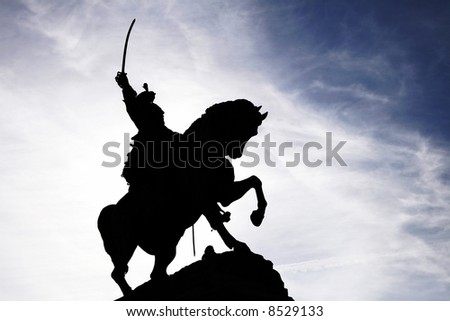 Statue Of Mounted Saber Rider On A Horse, Silhouette - stock photo